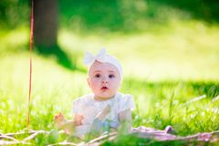 Baby girl on a sunny meadow portrait Royalty Free Stock Image
