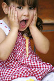 Baby girl surprised Stock Image