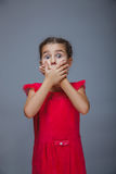 Baby girl surprised holding her hands near mouth Royalty Free Stock Image