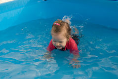 The baby girl swiming in pool Royalty Free Stock Photo