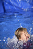 Baby girl  in the swimming pool Stock Photography