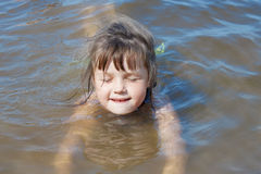 Baby girl swimming in the river Stock Photos