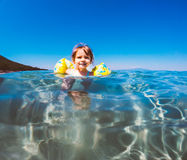 Baby girl swimming in sea Royalty Free Stock Image