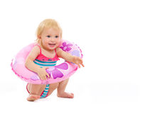 Baby girl in swimsuit sitting with inflatable ring Royalty Free Stock Images