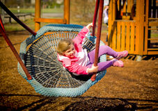 Baby girl on the Swing. Beautiful little girl on a swing.Germany,Hambrücken Children's playground Stock Photo
