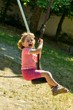 Baby girl on the Swing. Beautiful little girl play on swing at sunny park.Germany,Graben-Neudorf Royalty Free Stock Image
