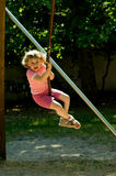 Baby girl on the Swing. Beautiful little girl play on swing at sunny park.Germany,Graben-Neudorf Stock Image