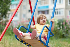 Baby girl on swing Royalty Free Stock Photo