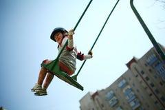 Baby girl on swing Stock Photo