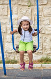 Baby girl on a swing Royalty Free Stock Image