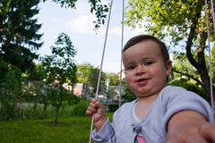 Baby girl in swing Stock Image