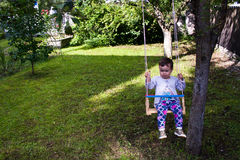 Baby girl in swing Royalty Free Stock Photo