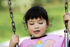 Baby girl swinging. Cute little girl swinging Royalty Free Stock Images