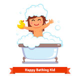 Baby girl taking bath with duck toy and bubbles Stock Image