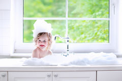 Baby girl taking bath with foam Stock Photos