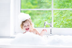 Baby girl taking bath with foam Royalty Free Stock Photos