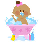 Baby girl taking a bath Stock Image