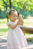 Baby girl taking photo by mobile 3 Stock Images