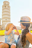 Baby girl taking photo of mother in pisa Royalty Free Stock Images