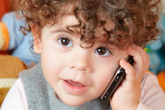 Baby girl talking on phone Royalty Free Stock Images