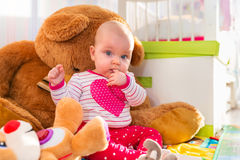 Baby girl with teddy bear Stock Image