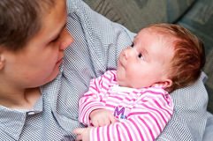 Baby girl with teenage brother Royalty Free Stock Photos