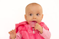 Baby girl with teether, isolated Royalty Free Stock Image