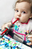 Baby girl testing colors in the classroom royalty free stock photo