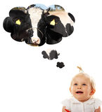 Baby girl thinking about cow (milk) Royalty Free Stock Image