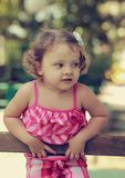 Baby girl with thinking look Royalty Free Stock Photography