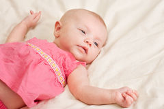 Baby Girl Toddler Lying on Bed Royalty Free Stock Photo