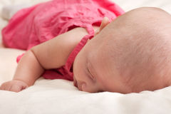 Baby Girl Toddler Lying on Stomach Royalty Free Stock Images