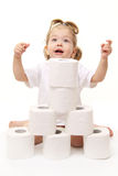 Baby girl with toilet paper Royalty Free Stock Image