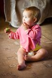 Baby girl with tomato Stock Photography