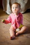 Baby girl with tomato Royalty Free Stock Image