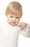 The baby girl with a tooth-brush Royalty Free Stock Images