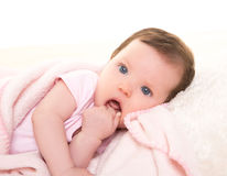 Baby girl with toothache in pink with white fur Royalty Free Stock Images
