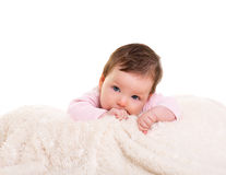 Baby girl with toothache in pink with on white fur. Baby girl with toothache in pink with winter white fur background Stock Photography