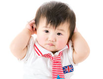 Baby girl touch ear Stock Photo