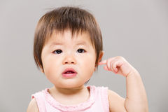 Baby girl touch her ear Stock Photography