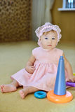 Baby girl with toy Royalty Free Stock Images