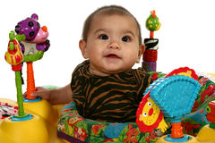 Baby Girl with Toy. Beautiful 3 month Hispanic baby playing with toys Royalty Free Stock Photography