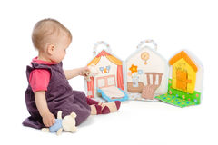 Baby girl with toy book royalty free stock photography