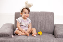 Baby girl with toy chicken and eggs Stock Images
