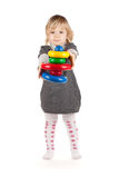 Baby girl with a toy pyramid Royalty Free Stock Images