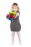 Baby girl with a toy pyramid Stock Images