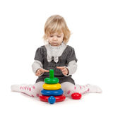 Baby girl with a toy pyramid Royalty Free Stock Photo