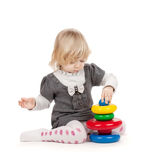 Baby girl with a toy pyramid Stock Photography
