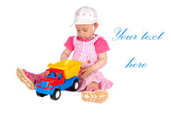 Baby girl with toy truck Stock Images