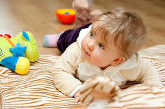 Baby girl with toys Royalty Free Stock Photos